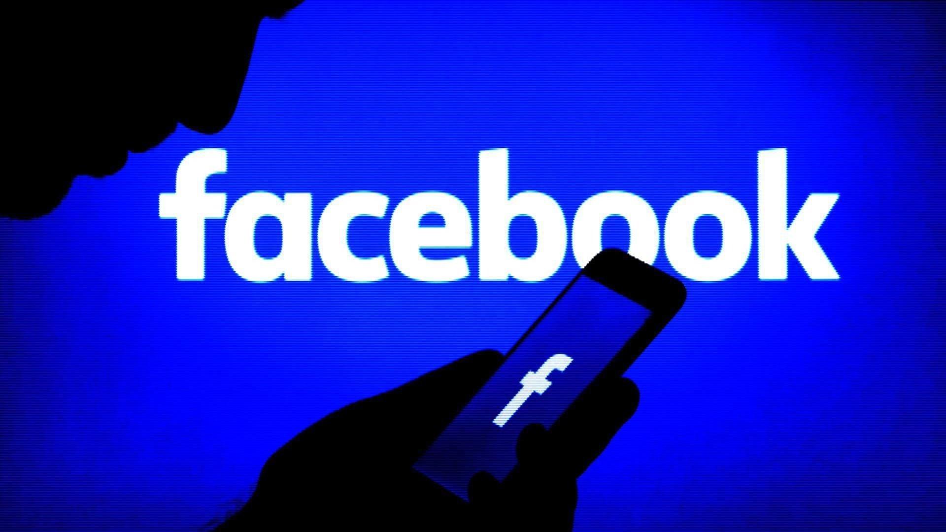 facebook azul sobre utilizador com telemovel