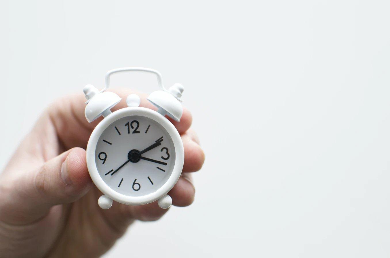 relógio numa mão
