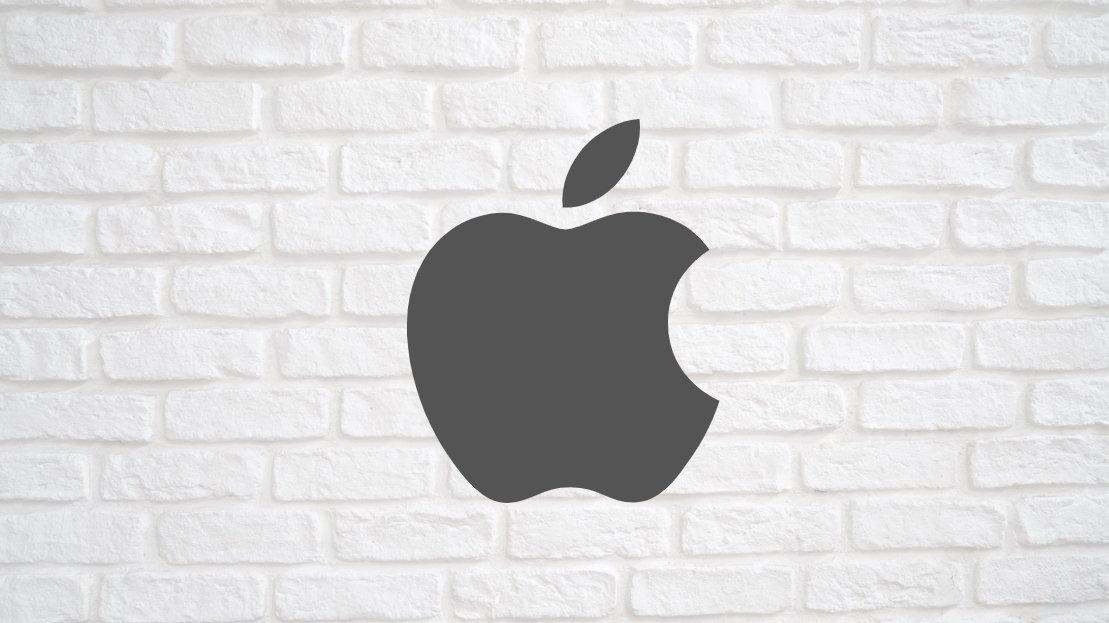 Apple logo sobre uma parede